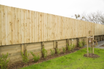 Wooden retaining wall example from Auckland Fences.