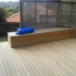 Deck with seat and trellis fence