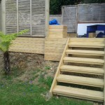 Deck with steps and trellis fence